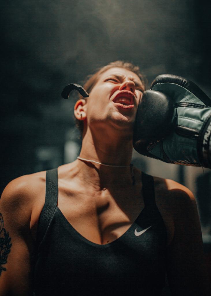 Female Boxer recieving an uppercut to the cheek
